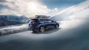 2020 nissan rogue driving through snow