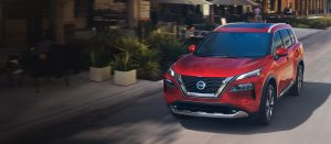 2020 nissan rogue in red on city street